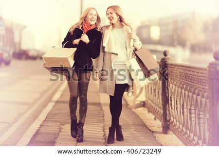 Spring sunny portrait of two friends in the city girl for a walk - stock photo