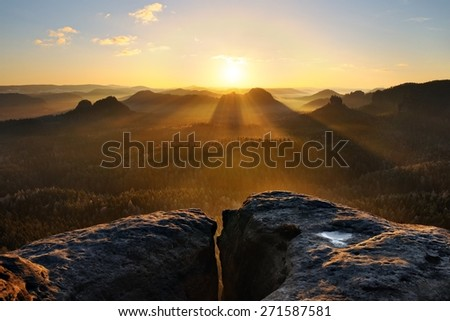 Spring sunrise above the misty and rocky valley in national park Saxony Switzerland - stock photo