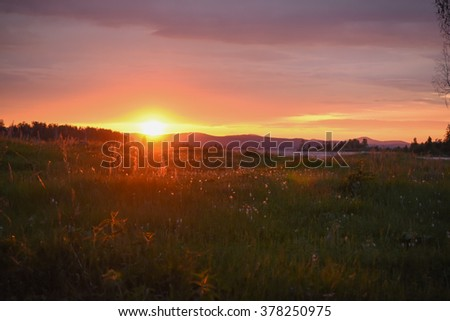Spring sunset on the lake, Landscape, sunny dawn in a field  - stock photo