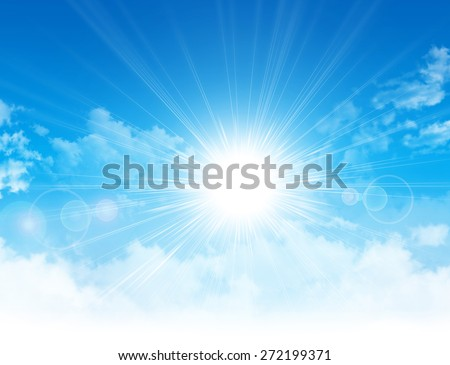 Spring sunshine. Sun light breaking through white clouds in blue sky - stock photo