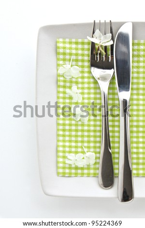 Spring table place setting with knife and fork - stock photo