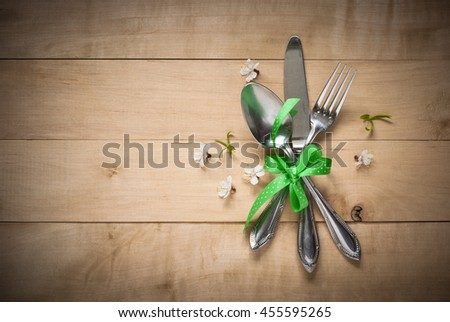 Spring table setting with  cutlery and flowers. Silverware in spring scenery. - stock photo