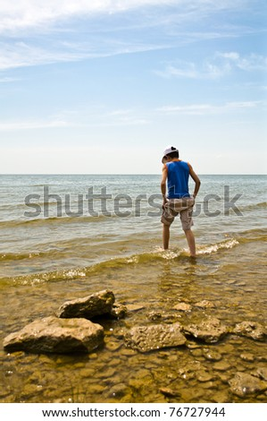 Spring, the boy goes to sea - stock photo