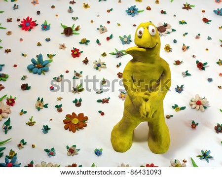 Spring time concept , flowers and smiling character made in plasticine
