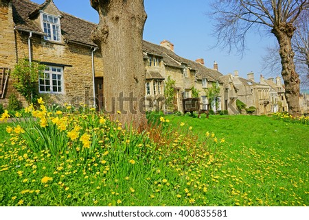 Spring time in Burford with daffodils and beautiful blue sky,The Cotswolds, Oxfordshire, United Kingdom - stock photo