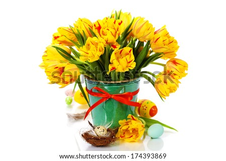 spring tulips with easter eggs on white background - stock photo