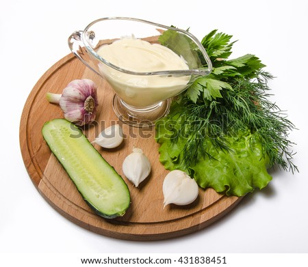 spring vegetables with mayonnaise on cutting board - stock photo