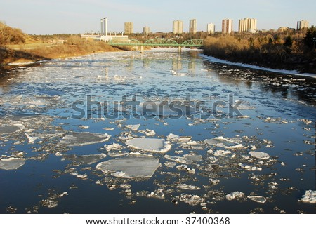 Spring view of icy north saskatchewan river in sunset moment, edmonton, alberta, canada