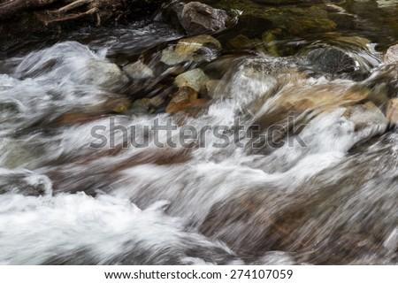 Spring water flowing over rocks in to Lake Tahoe from the California side - stock photo