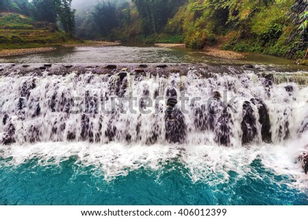spring Waterfall Tien Sa falls, Sapa village, Lao Cai Province, Northwest Vietnam - nature landscape in Vietnam Northwest - stock photo