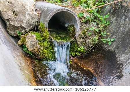 spring with clean drinking water - stock photo