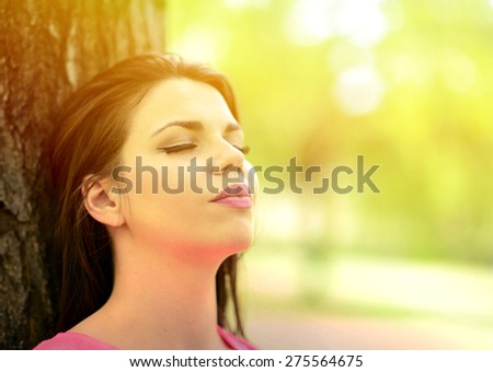 Spring woman enjoying nature on a beautiful summer day
