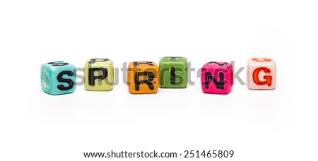 spring - word made from multicolored child toy cubes with letters