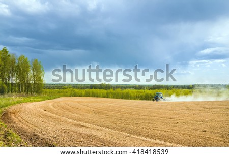 Spring work in the field - stock photo