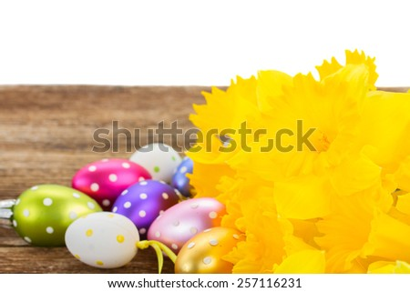 spring yellow daffodils with easter eggs border  isolated on white background - stock photo