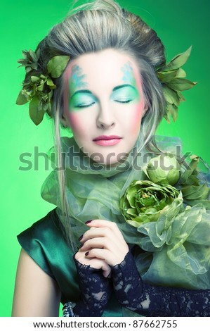 Spring. Young beautiful woman in creative image.