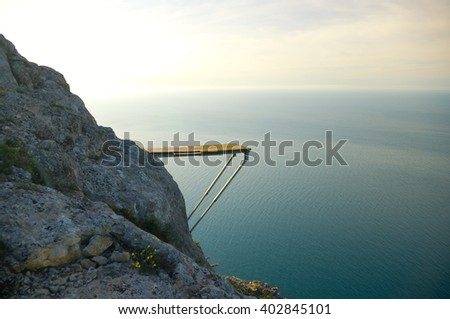 Springboard for a diving from a rock. - stock photo
