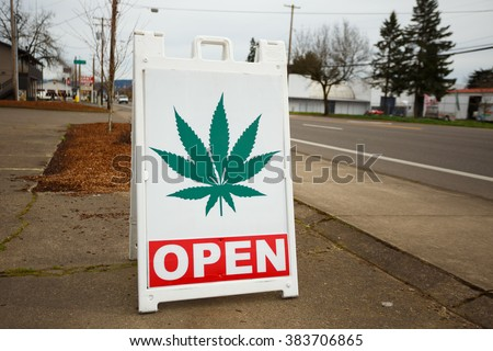 SPRINGFIELD, OR - FEBRUARY 16, 2016: Marijuana dispensaries like this one have popped up in large number due to a law change in Oregon legalizing pot for recreational purposes. - stock photo