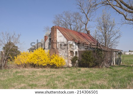 Springtime at the old farm house. - stock photo