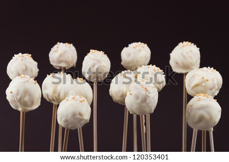 Sprinkled cake pops covered with white chocolate