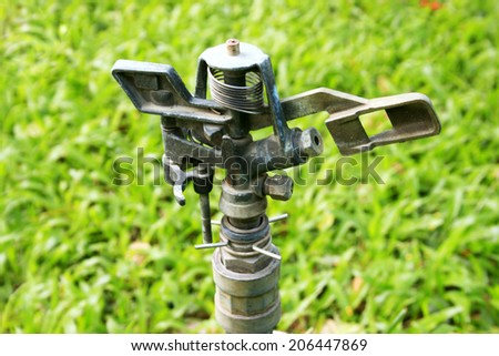 sprinkler head in the garden - stock photo
