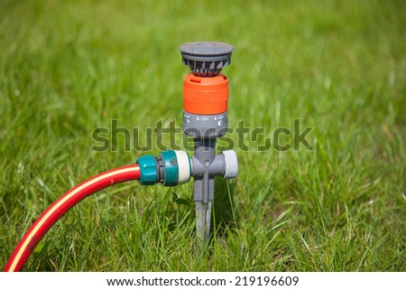 Sprinkler in garden - stock photo