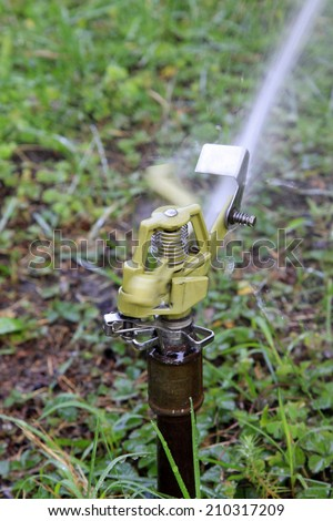 Sprinkler irrigation facilities in the botanic garden, closeup of photo