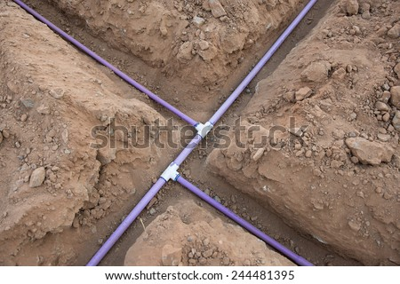 Sprinkler system pipe in dirt trenches for underground irrigation system using reclaimed water.