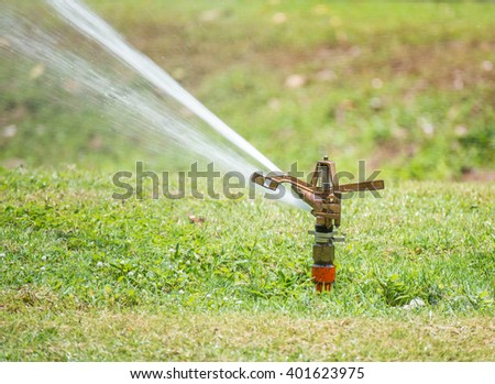 Sprinkler watering - stock photo