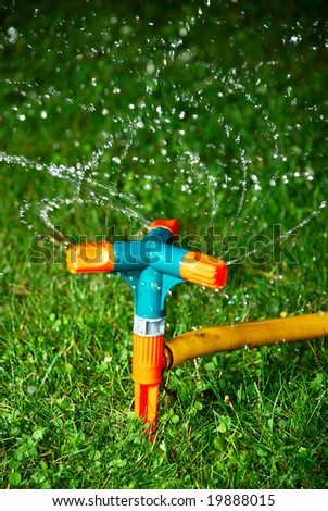 Sprinkler watering at night a grass
