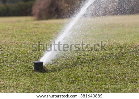 Sprinkler watering in golf course