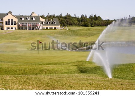 Sprinklers on a Golf Course - stock photo
