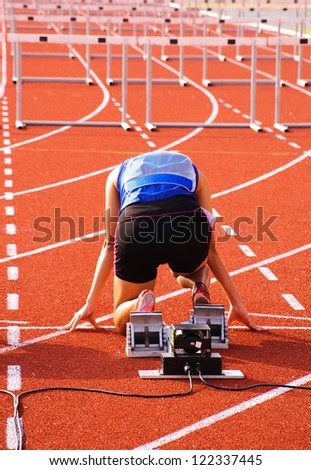 Sprinter is in start position. - stock photo