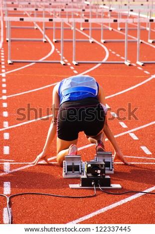 Sprinter is in start position. - stock photo