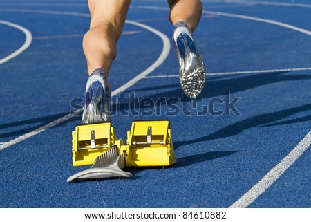 Sprinter is starting from starting block - stock photo