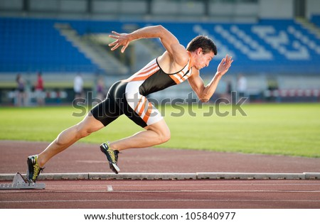 Sprinter Leaving Starting Blocks On Running Stock Photo 105840977 ...