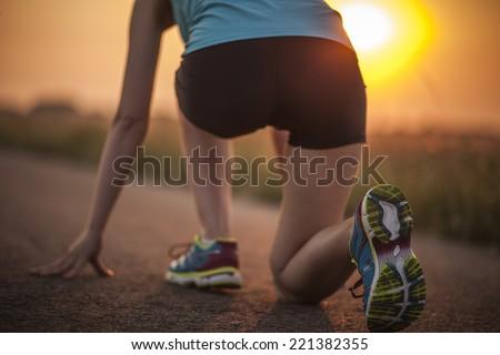 Sprinter start position on the track. Jogging sport - stock photo