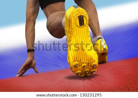 Sprinter starts on surface with russian national colors - stock photo