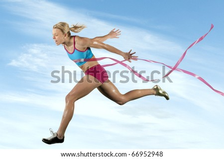Sprinter wins by crossing the finish line. - stock photo