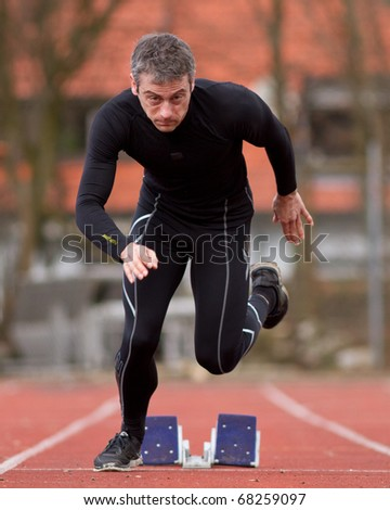 sprinting in track and field - stock photo