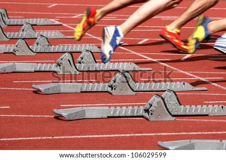 sprintstart in track and field - stock photo