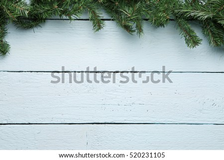 Spruce branch on white wooden surface. New year, Christmas background