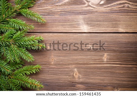 Spruce twigs on a wooden background. - stock photo