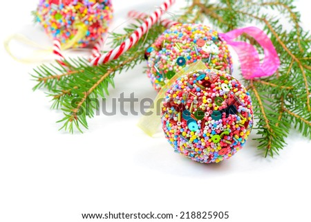 Spruce with Christmas balls and candy canes - stock photo