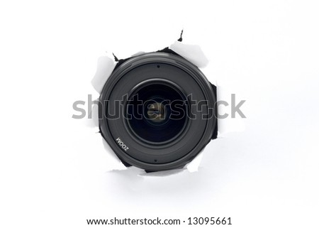 Spy concept. Camera lens hiding behind the white paper wall. - stock photo