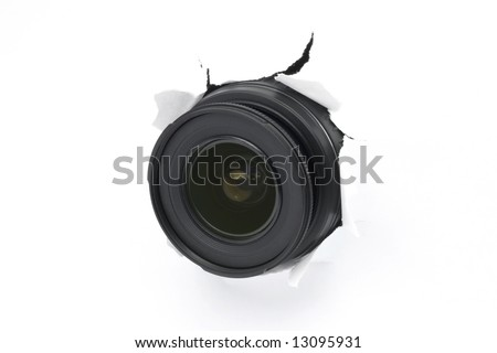 Spy concept. Camera lens hiding behind the white paper wall, ready to take a snapshot. Close up. - stock photo