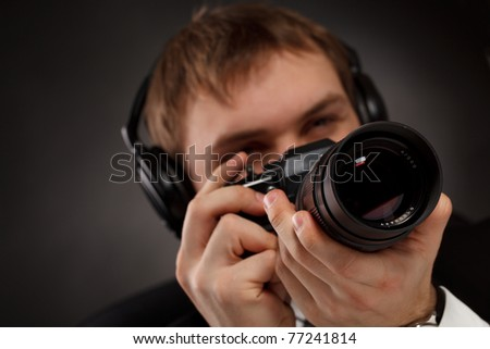 Spy with camera. - stock photo