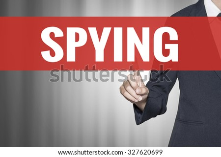 Spying word on virtual screen push by business woman red tab - stock photo