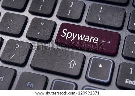 spyware concepts, with message on enter key of keyboard.