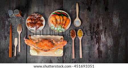 Sqide,jumbo crab and shrimp on dark background and space for text - stock photo